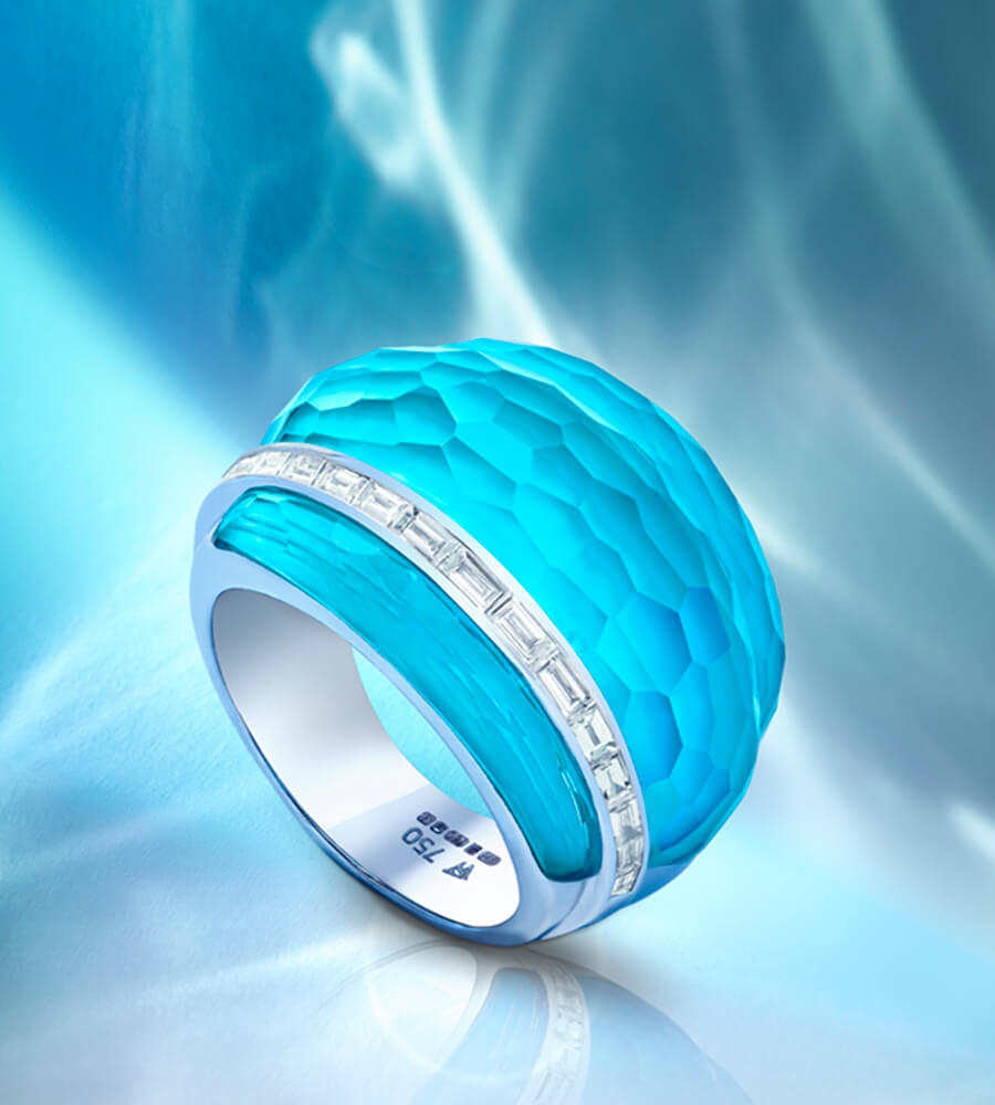 The new CH2 Cocktail Ring in Dark Turquoise Crystal Haze accentuated with baguette white diamonds set in 18ct white gold.