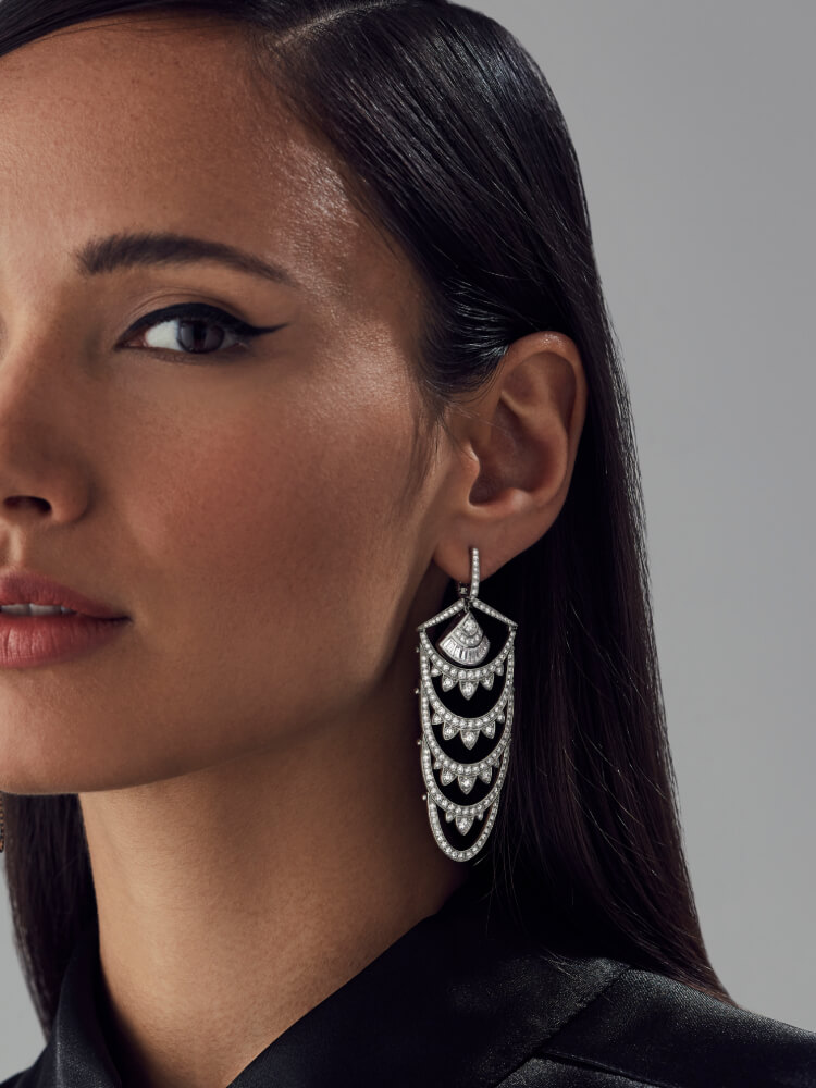 Deco New York Earrings in white diamonds and white gold on model.