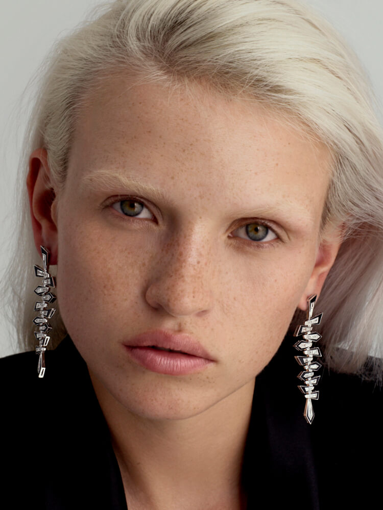 Dynamite Shattered Earrings in white diamond, black enamel and white gold on model.