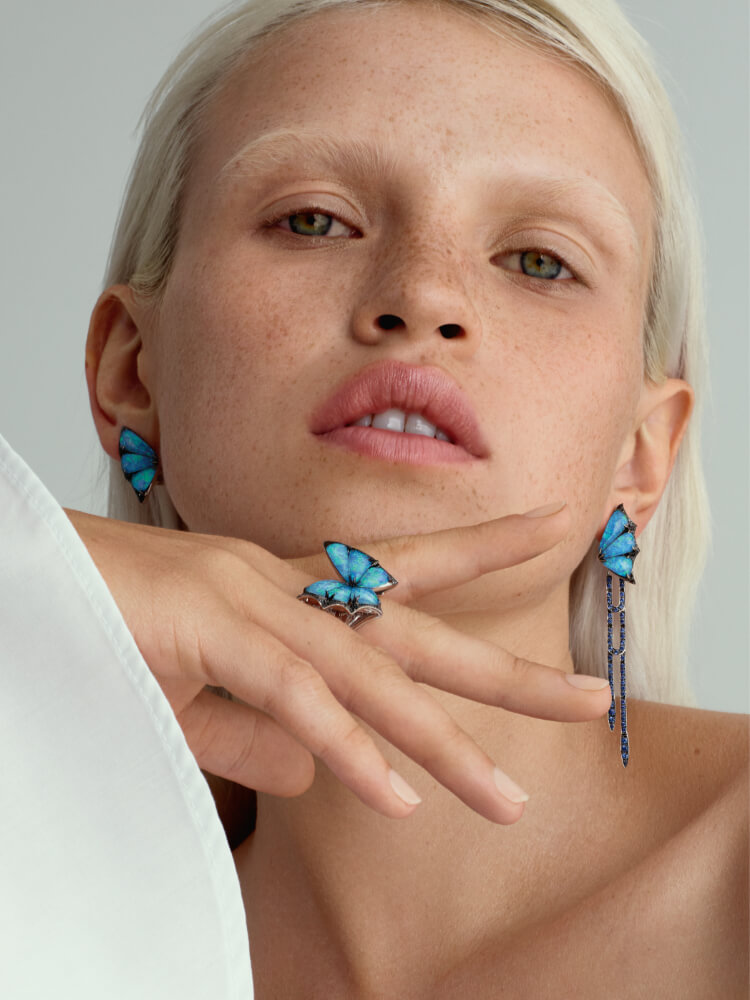Fly By Night Long Earrings and Ring in black opalescent crystal haze and white gold on model.