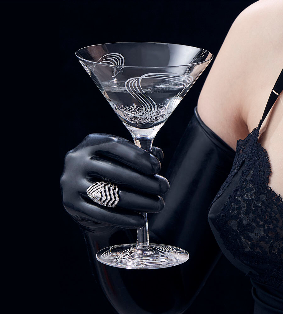 The Lady Stardust White Diamond Ring worn by model holding the Russian Roulette Martini Glass.