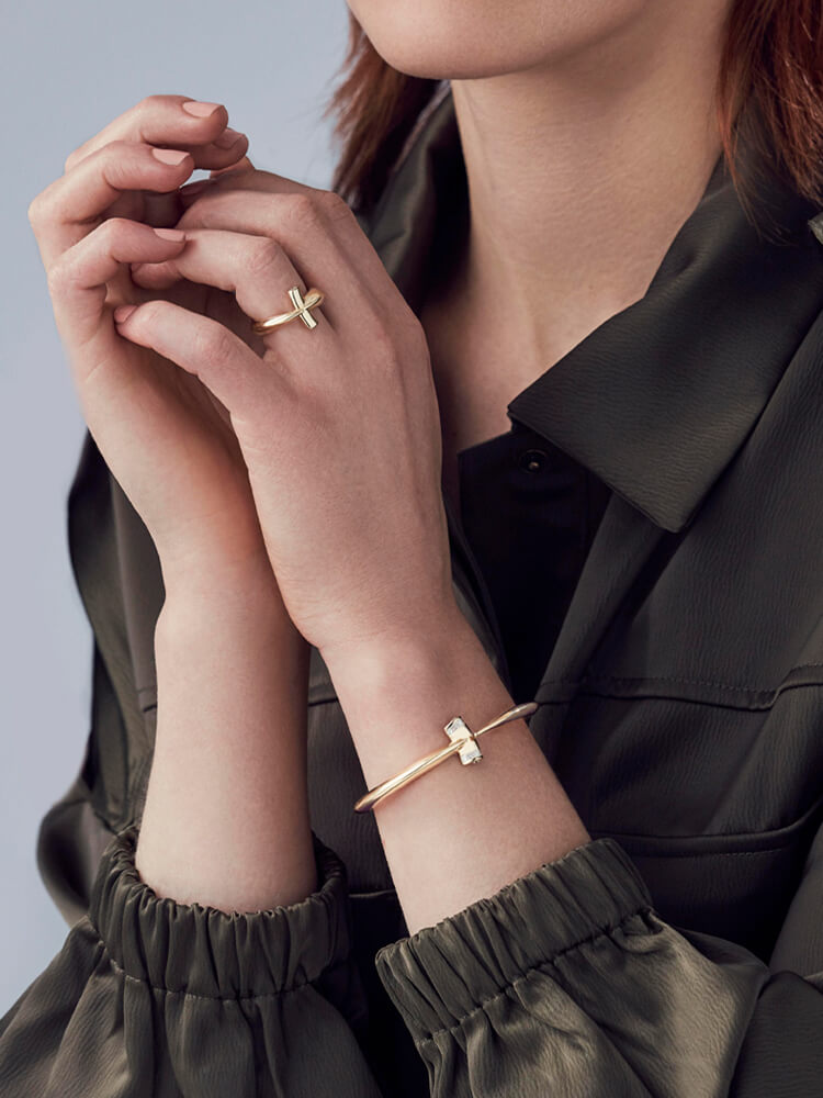 Hammerhead bangles and rings on model.