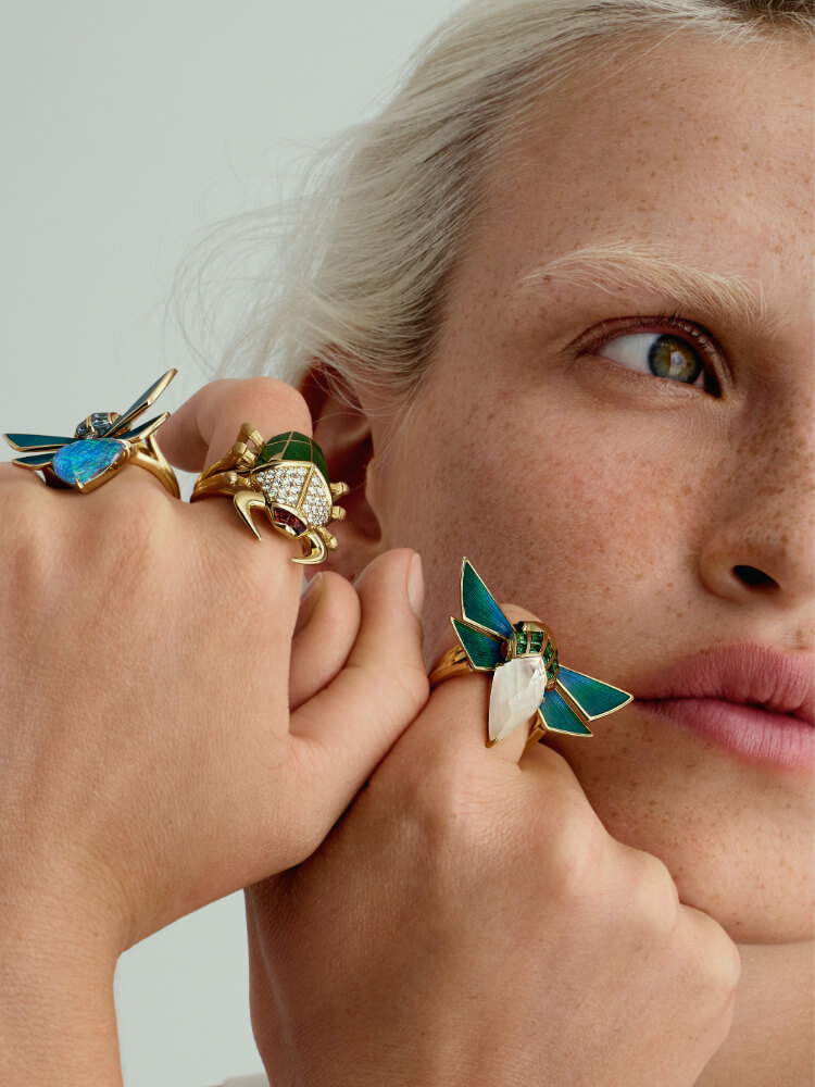A collection of Jitterbug rings worn on model.
