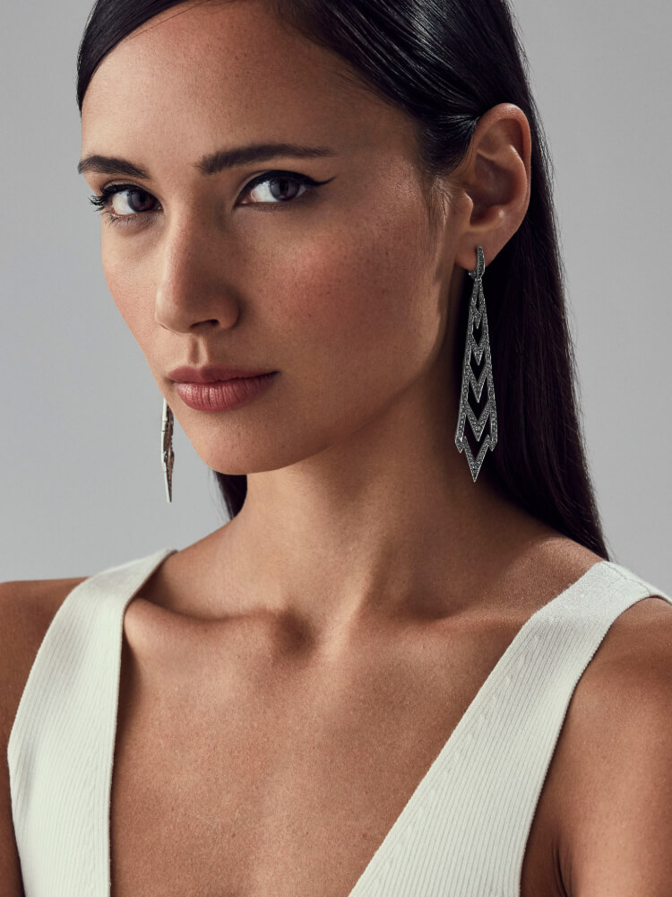 Lady Stardust Long Earrings in black diamonds and white gold on model.