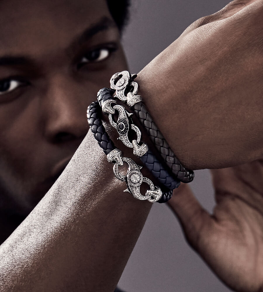 Model wearing the England Made Me Leather Bracelets with Cuban Leaf Screw Clasps.