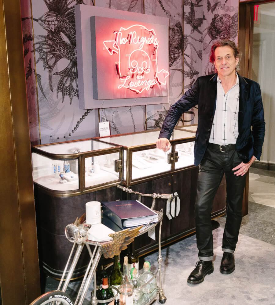 Stephen Webster standing in the No Regrets Lounge in Bergdorf Goodman, New York.