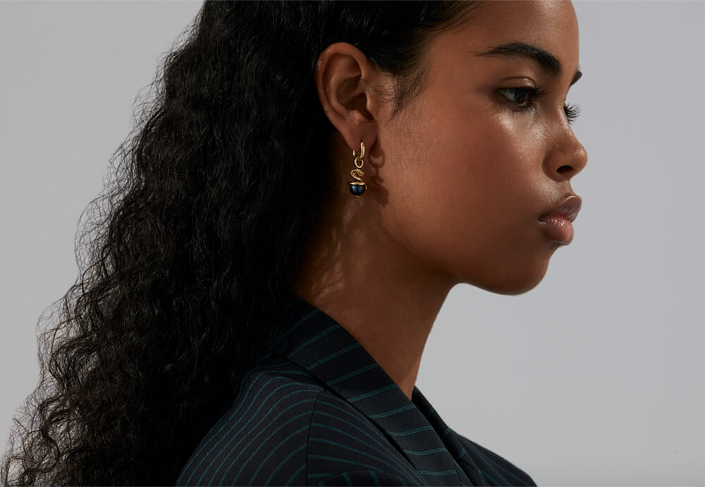 The Ophiuchus Astro Ball worn as an earring with a Sleeper from Stephen Webster's 'Astro Ball' collection.