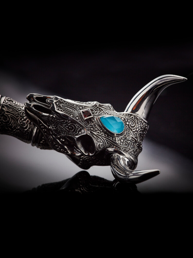 Close up of the Tequila Lore Cow Cocktail Strainer with Turquoise Crystal Haze.