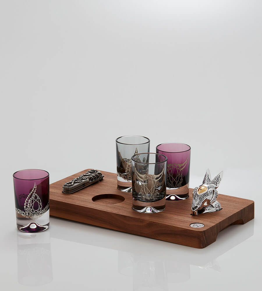 Tequila Lore Shot Glass Set with four shot glasses, Rabbit Salt Shaker, Snake Swiss Army Knife, and Wooden Board.