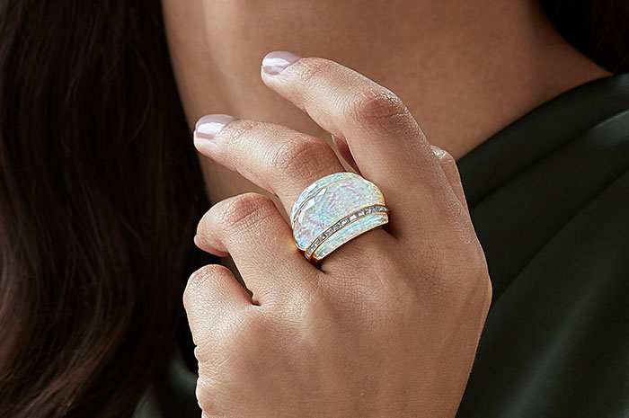 Model wearing the CH2 Cocktail Ring in White Opalescent Crystal Haze set in 18ct yellow gold.