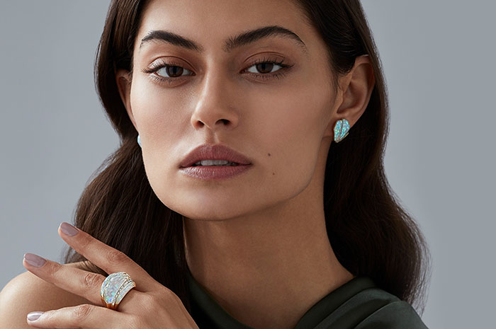 Model wearing the CH2 Cocktail Ring and Cuffing Earrings in White Opalescent Crystal Haze set in 18ct yellow gold.