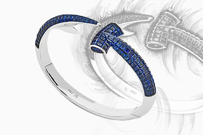 Stephen Webster's Hammerand Bangle set with blue Sapphires in 18ct white Gold.